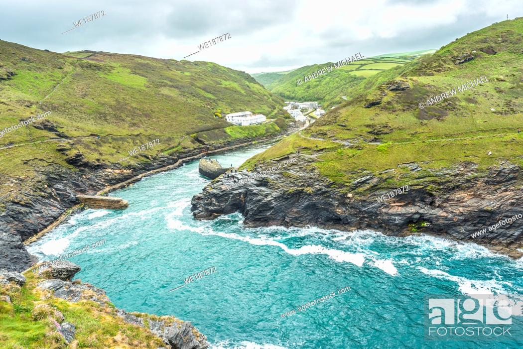 Stock Photo: Spectacular views from the top of Warren point looking towards Boscastle Harbour entrance and the village beyond, North Cornwall, England, UK.