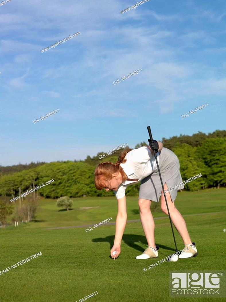 Stock Photo: Woman at golf tee.