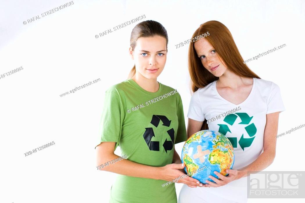 Stock Photo: two girls holding globe.