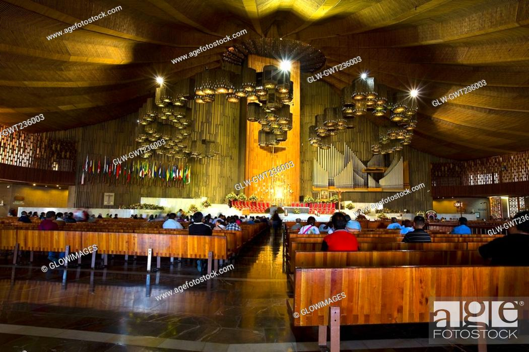 Stock Photo: Group of people praying in a church, Basilica De Guadelupe, Mexico City, Mexico.