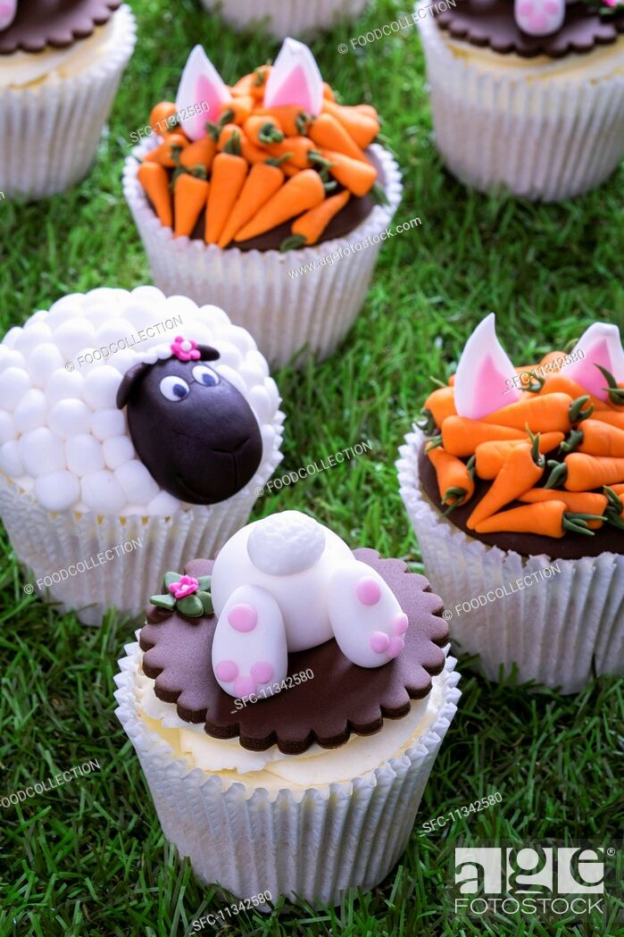 Stock Photo: Various Easter cupcakes on a grass surface.