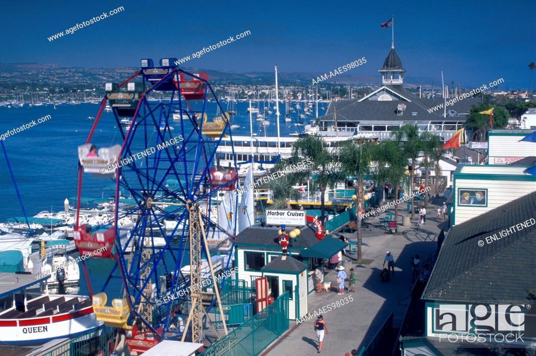 Ferris Wheel And Promenade On