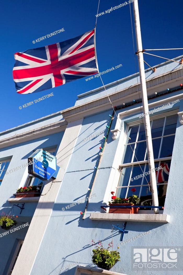 Stock Photo: England Devon Dartmouth Conservative Club Detail of Union Jack Flag.