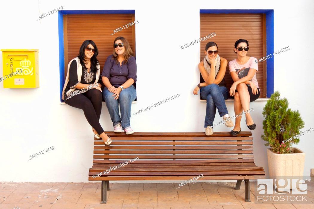 Stock Photo: Girls posing in bench, Popular festivities in Carricola, Valencia.