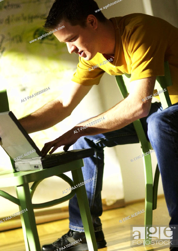 Stock Photo: Man working on laptop computer.