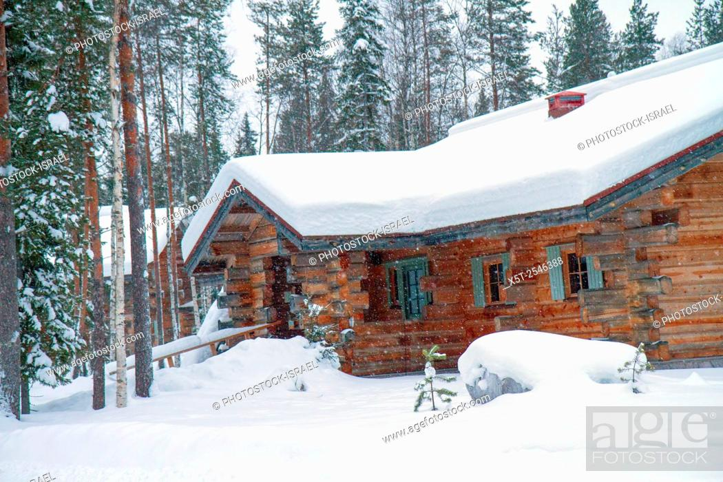 Stock Photo: Lapland, Scandinavia, a snow covered wood cabin in a landscape of snow.