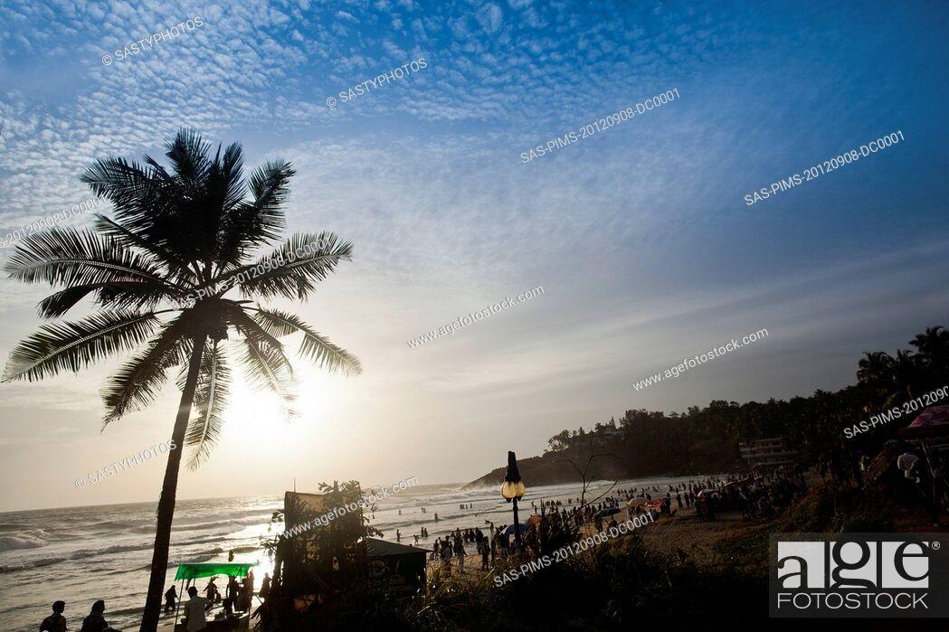 Stock Photo: Tourists on the beach, Kovalam, Kerala, India.