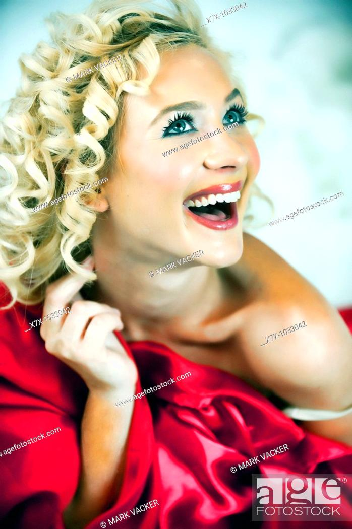 Stock Photo: Pretty, young, sexy blonde girl smiling.