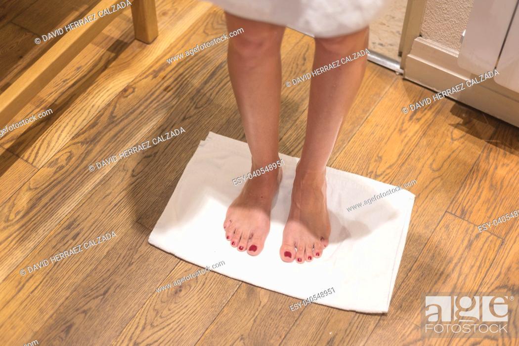 Stock Photo: Female legs in bath towel.
