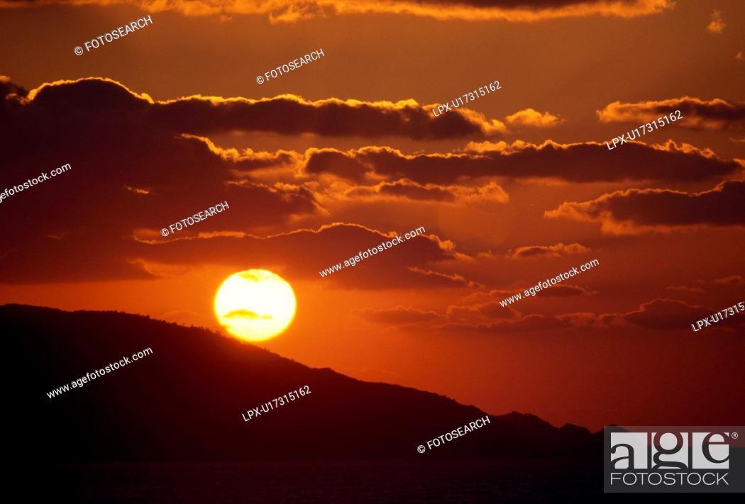 Stock Photo: Vibrant sunset over hill. Fukuoka Prefecture, Japan.