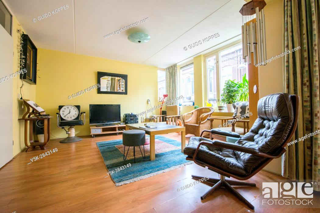 Stock Photo: Tilburg, Netherlands. Interior shot of an apartment living room with saloon chairs and furniture.