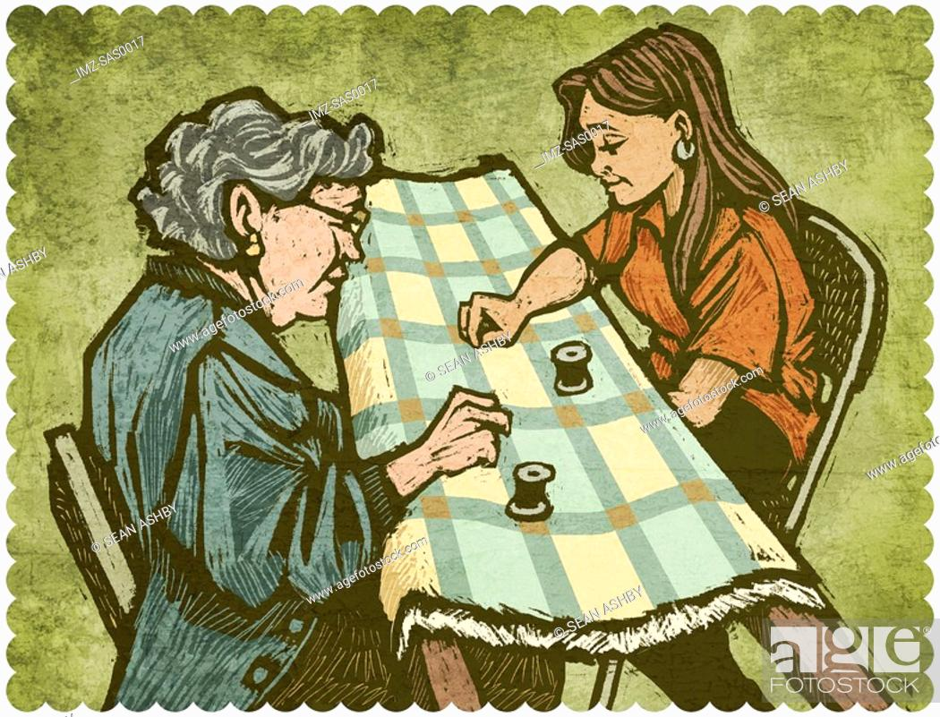 Stock Photo: Two women making a quilt together.