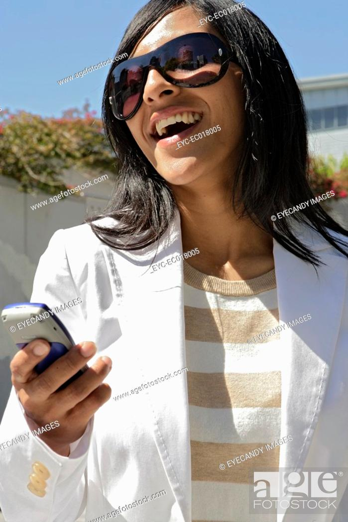 Stock Photo: Portrait of a young woman holding a cellphone.