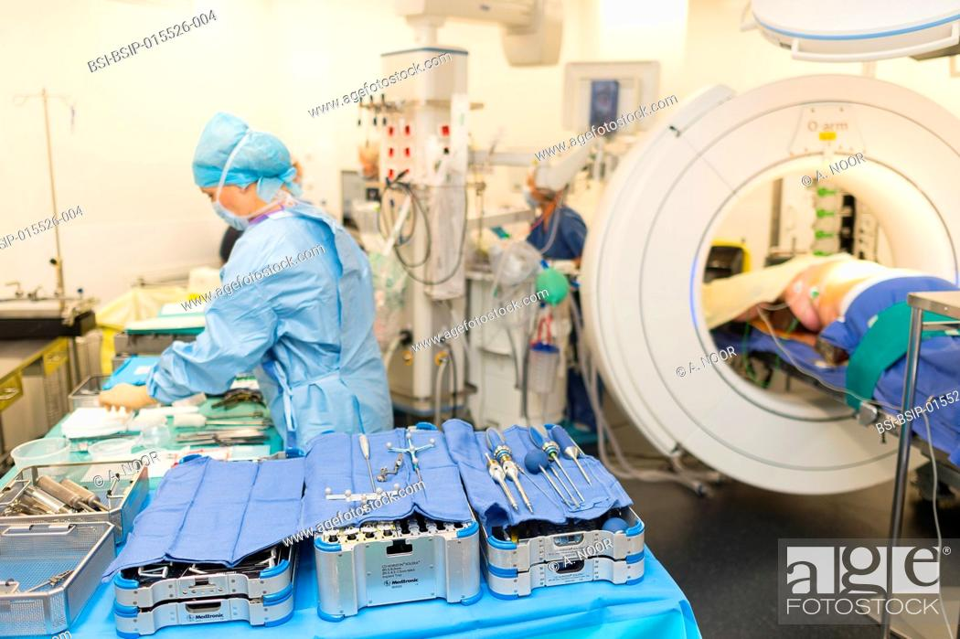 Stock Photo: Reportage in the orthopedic surgery operating theatre in Pasteur 2 Hospital, Nice, France. Medullary liberation and arthrodesis in a patient suffering from.