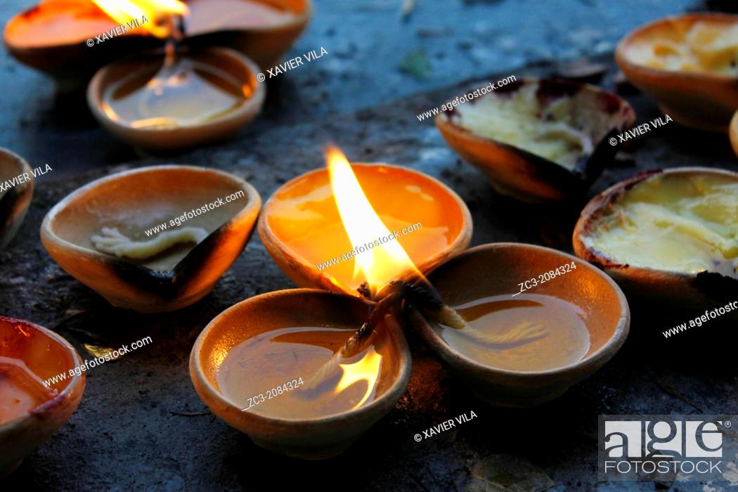 Stock Photo: Candles with oil inside the sacred temple near Batu Caves who are a set of caves, some of which have been converted into temples.