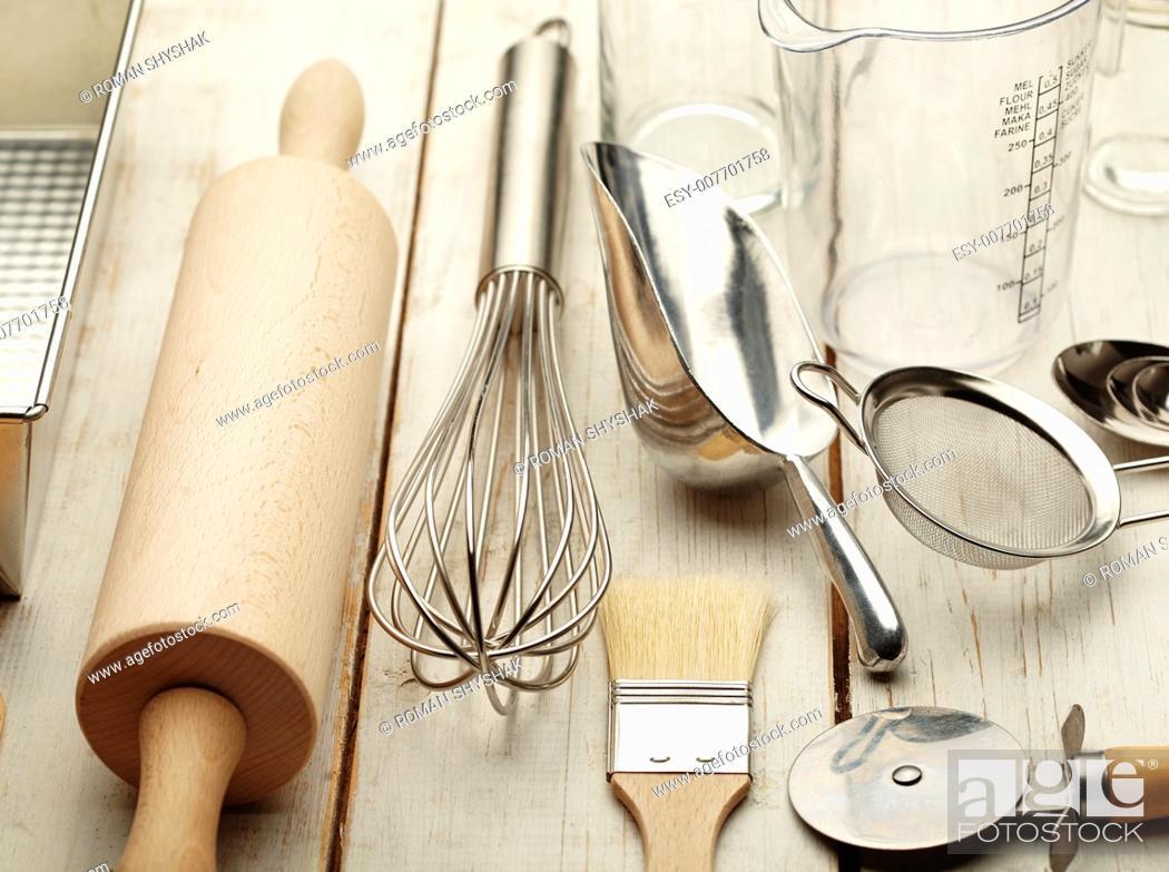 Stock Photo: Kitchen baking utensils against white desk.