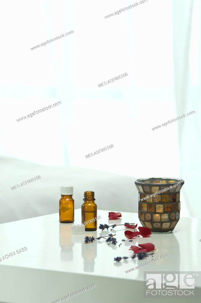 Stock Photo: Aroma oil with lavender flower on table, close up.