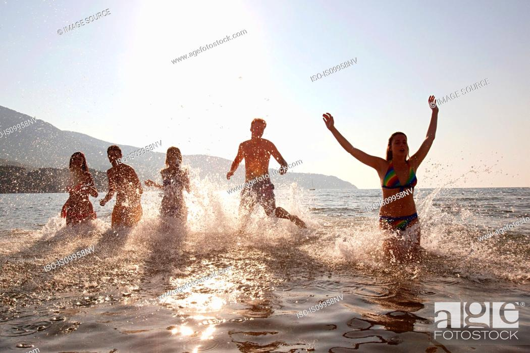Stock Photo: Young friends splashing in the sea.