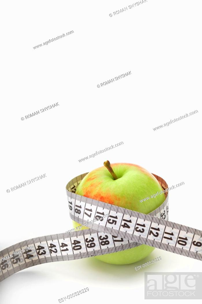 Stock Photo: Apple with a measuring tape on white.