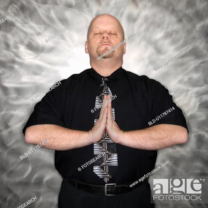 Stock Photo: Bald man standing in a meditative position.