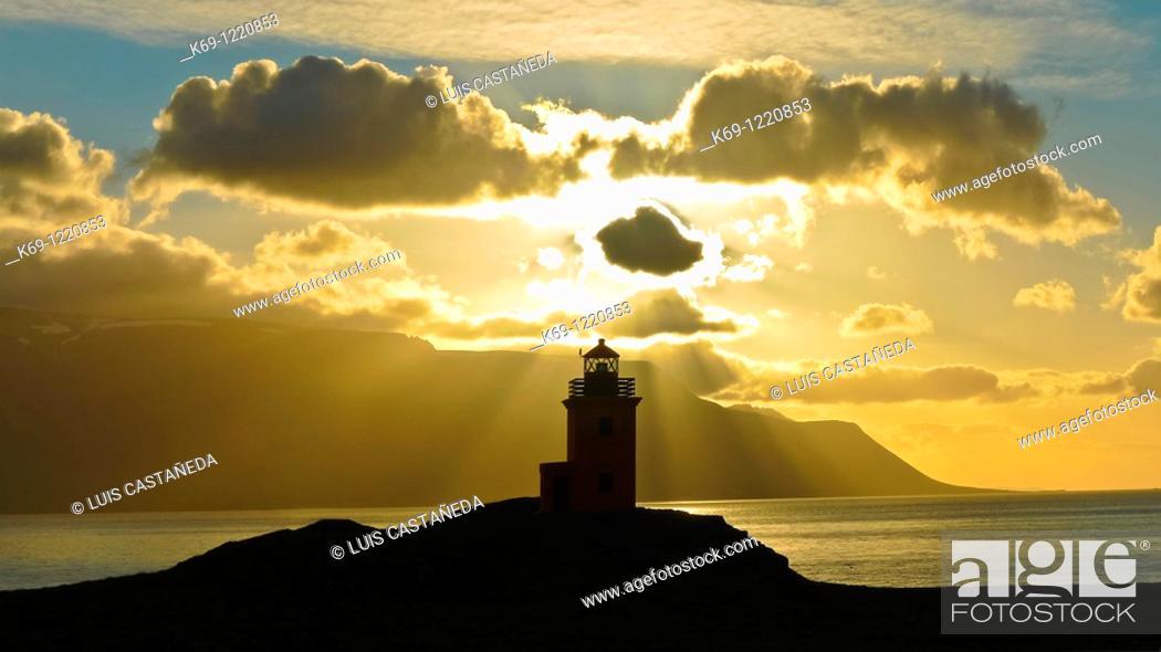 Stock Photo: Lighthouse at Sunset  Iceland.
