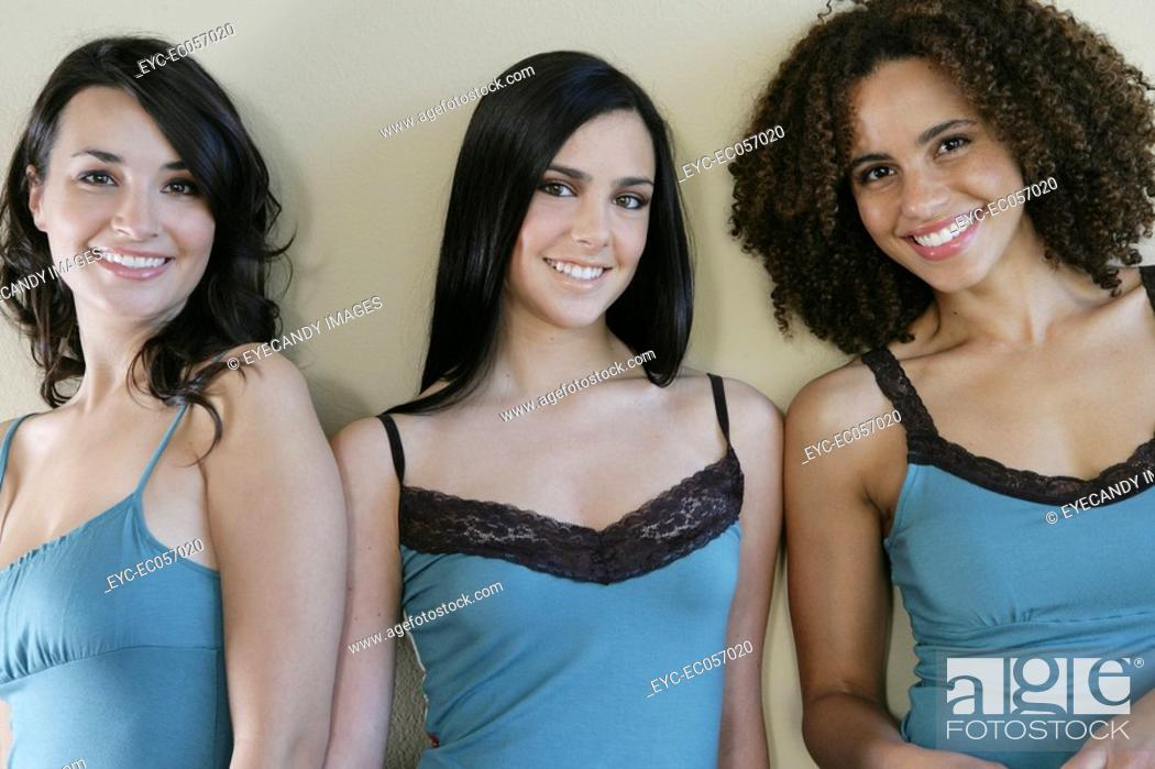 Stock Photo: Three young women posing in lingerie.