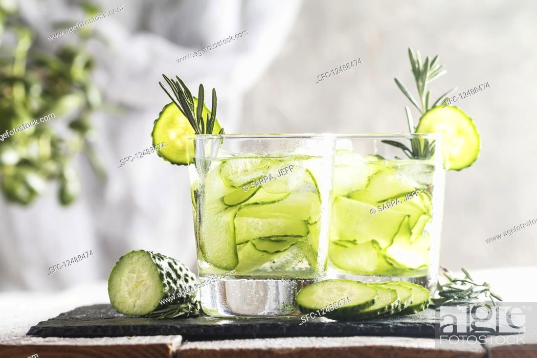 Stock Photo: Glasses with fresh organic detox cucumber water.