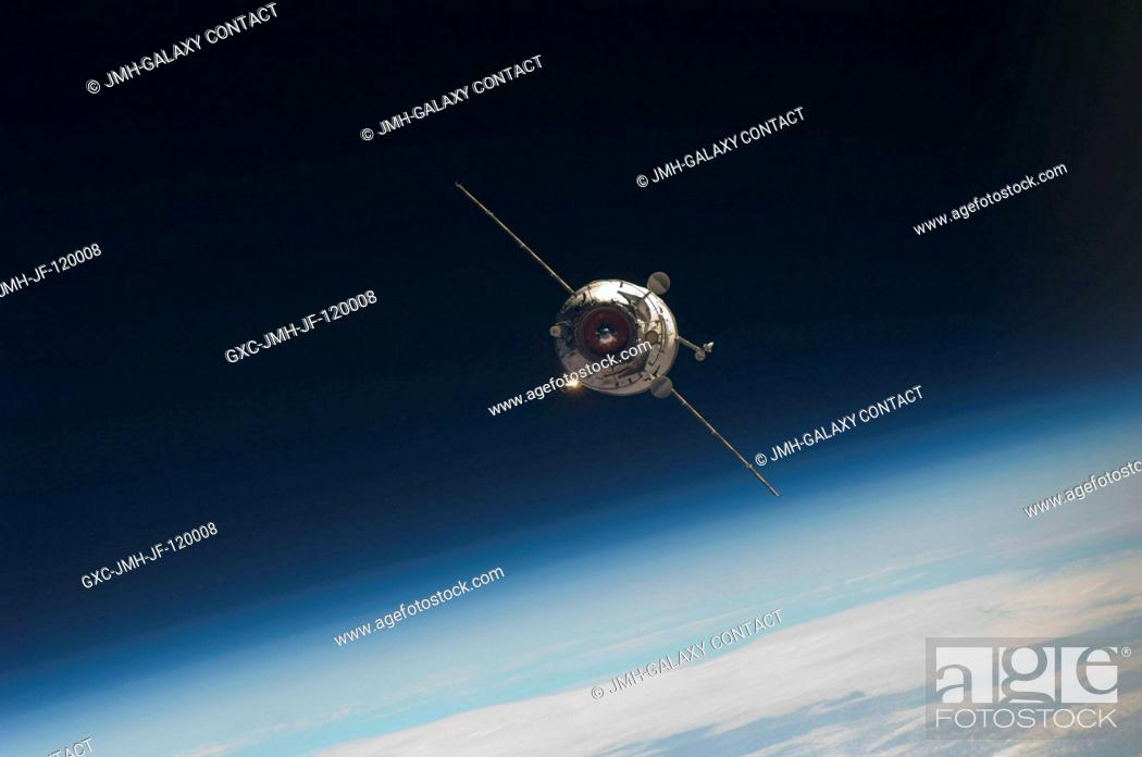 Stock Photo: Backdropped by Earth's horizon and the blackness of space, the new unpiloted Russian Mini-Research Module 2 (MRM2), also known as Poisk.