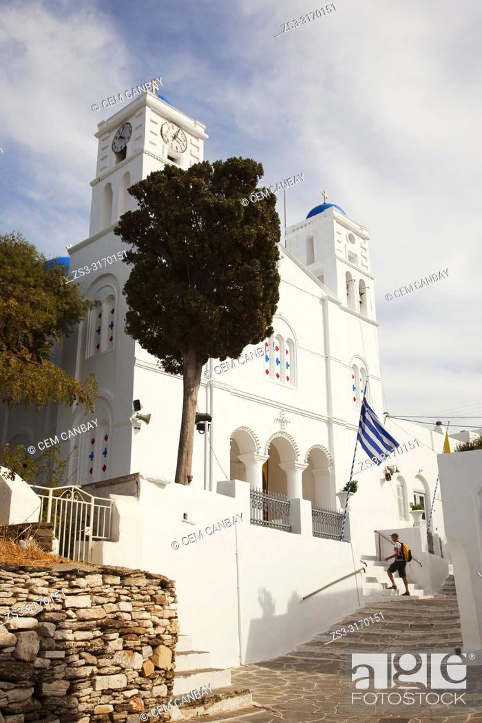 Stock Photo: Tourist in front of the Agios Spiridonos Church in Apollonia village, Sifnos Island, Cyclades Islands, Greek Islands, Greece, Europe.