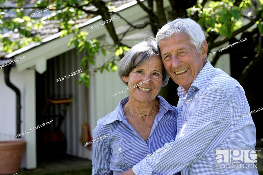 Stock Photo: Germany, Bavaria, Senior couple smiling, portrait.