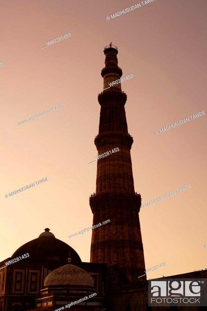 Stock Photo: Sunset at Alai Darwaza Imam Zamins tomb and Qutab Minar built in 1311 red sandstone tower , Indo-Muslim art , Delhi sultanate , Delhi.