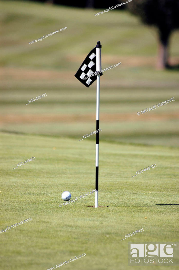 Stock Photo: Golf ball and hole.