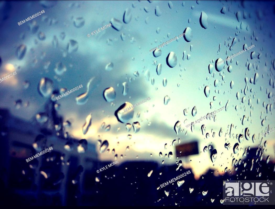 Stock Photo: Close up of raindrops on window.