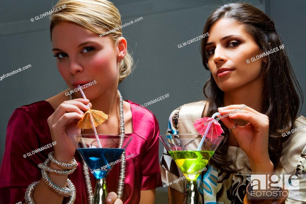 Stock Photo: Portrait of two young women drinking cocktail.