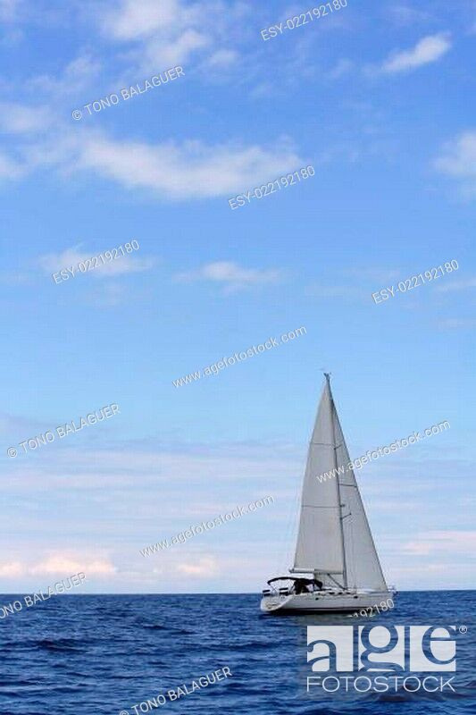 Stock Photo: Blue sea with sailboat sailing the ocean surface.