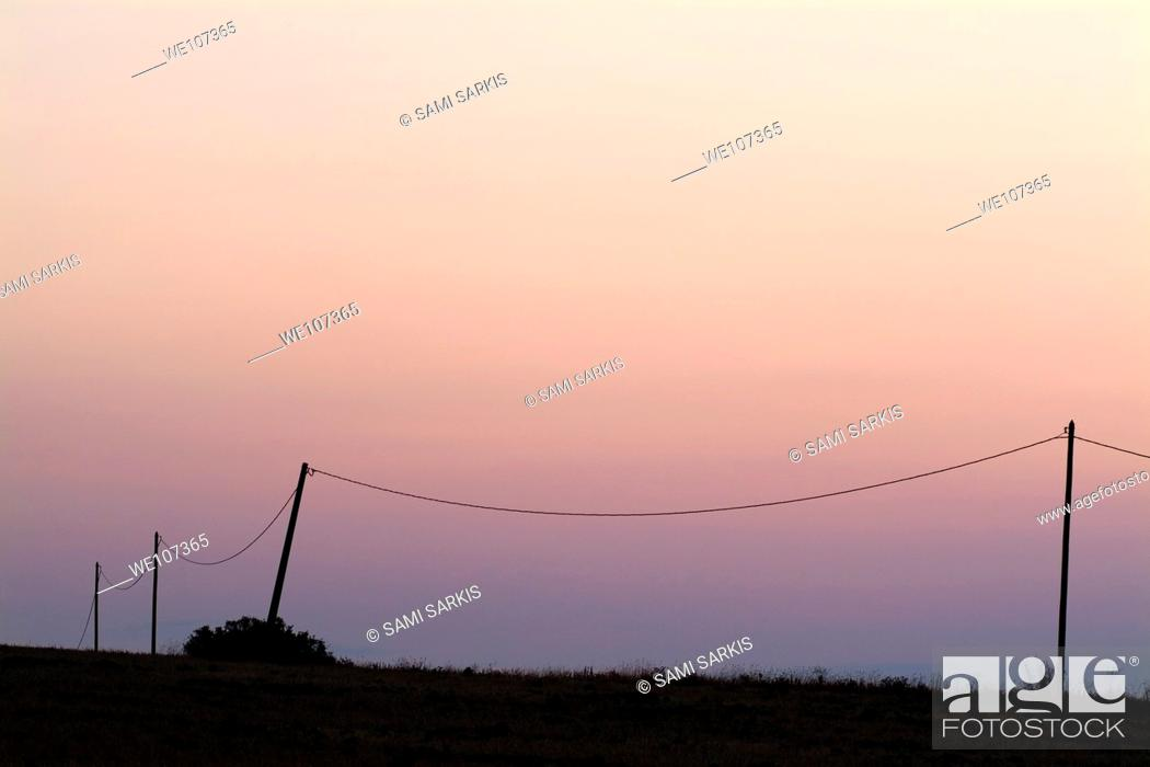 Stock Photo: Three old electrical pylons at sunrise, Carcassonne, Alzonne, France.