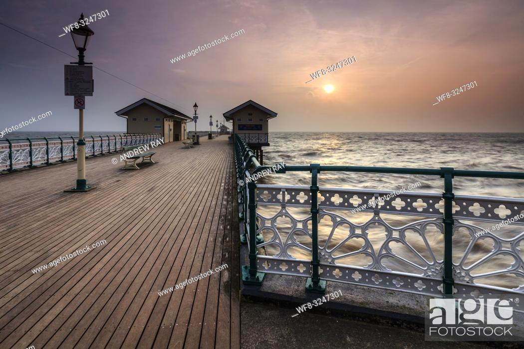 Stock Photo: Rising Sun from Penarth Pier.