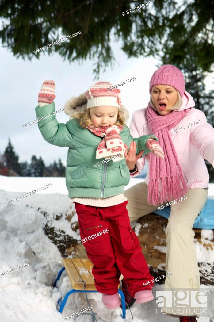 Stock Photo: Mother and daughter playing in snow.
