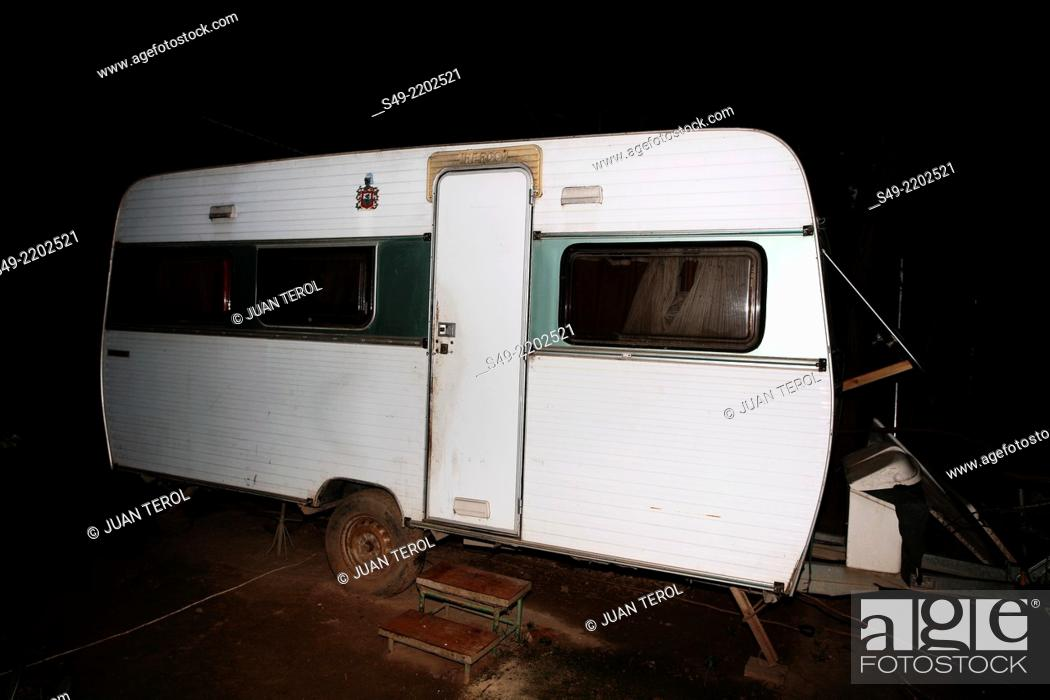 d9b78b466eb177 Stock Photo - Abandoned camper in field