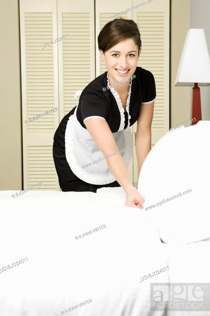Stock Photo: Maid making bed.