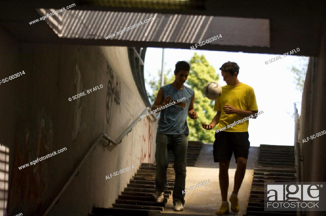 Stock Photo: Teenage boys in underpass.