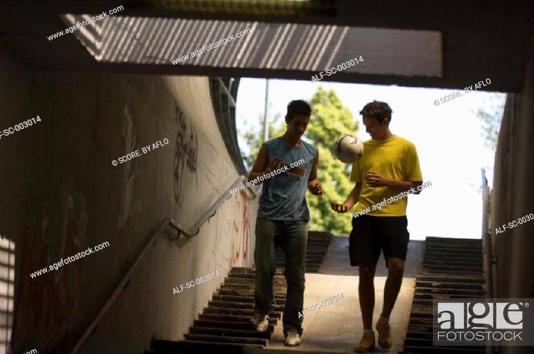 Stock Photo: Teenage boys in underpass.