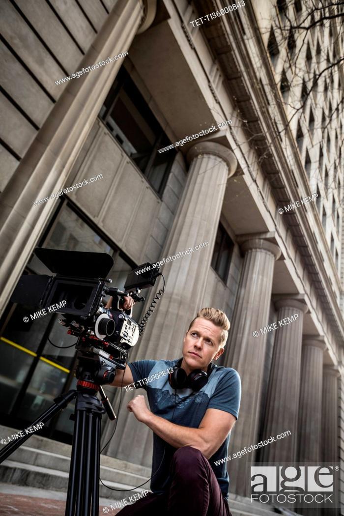 Stock Photo: Serious camera operator looking away.