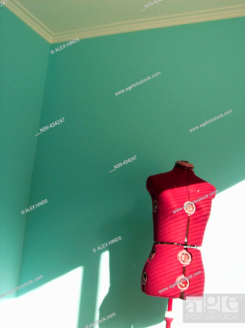 Stock Photo: Dress makers dummy lit by bright sunshine.