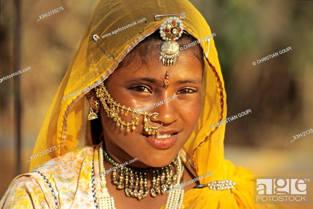 Stock Photo: portrait of young woman at Shilpgram Village around Udaipur, State of Rajasthan, India, South Asia.