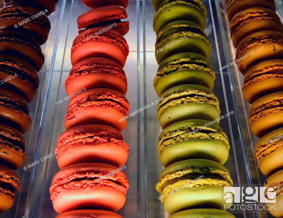 Stock Photo: A macaron or macaroon is a sweet meringue-based confection made with egg white, icing sugar, granulated sugar, almond powder or ground almond, and food coloring.