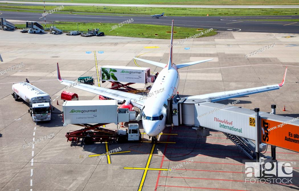 Stock Photo: An Air Berlin Boeing 737 at the gate, check-in, loading, unloading, catering, refuelling, baggage loading, Duesseldorf International Airport, Duesseldorf.