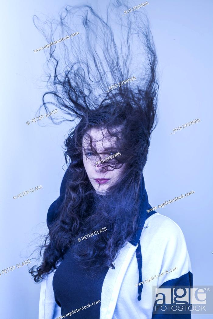 Stock Photo: Teenage girl with hair blowing.
