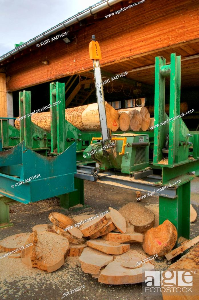 Stock Photo: Large chain saw with cut segments of trunks, sawmill, timber trade, logs, timber storage, timber, high-quality construction timber, lumber, Vorarlberg, Austria.