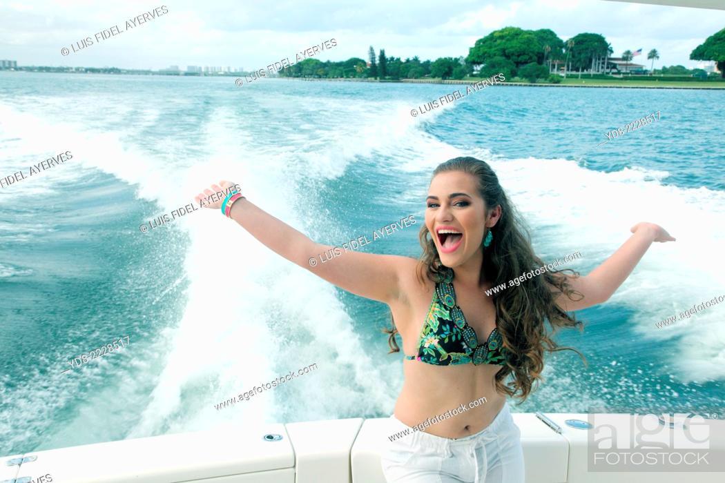 Stock Photo: Young Quinceañera enjoying a cruising along the coast of Miami, Florida, USA.